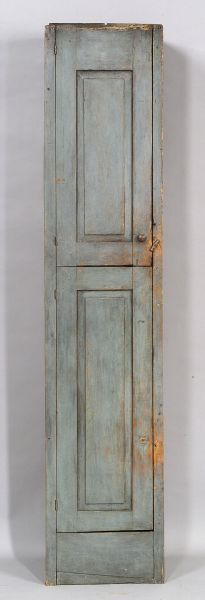 Gray Painted Pine Chimney Cupboard, New England, late 18th century, the two hinged doors with raised panels opening to a shelved interior, painted gray-blue, 84 H. x 17.75 W. x 12.5 D.