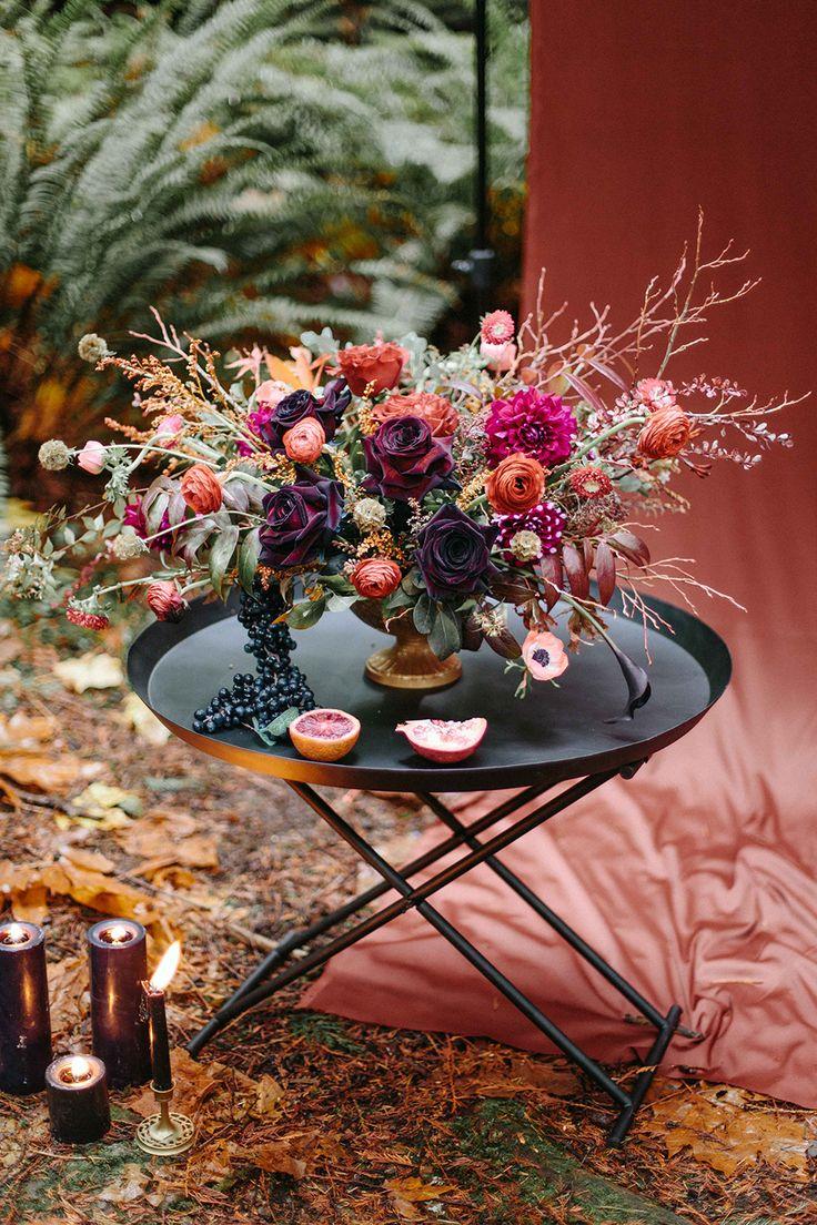rich toned florals - photo by INGAVEDYANweddings and fashion http://ruffledblog.com/moody-burgundy-and-gold-wedding-inspiration