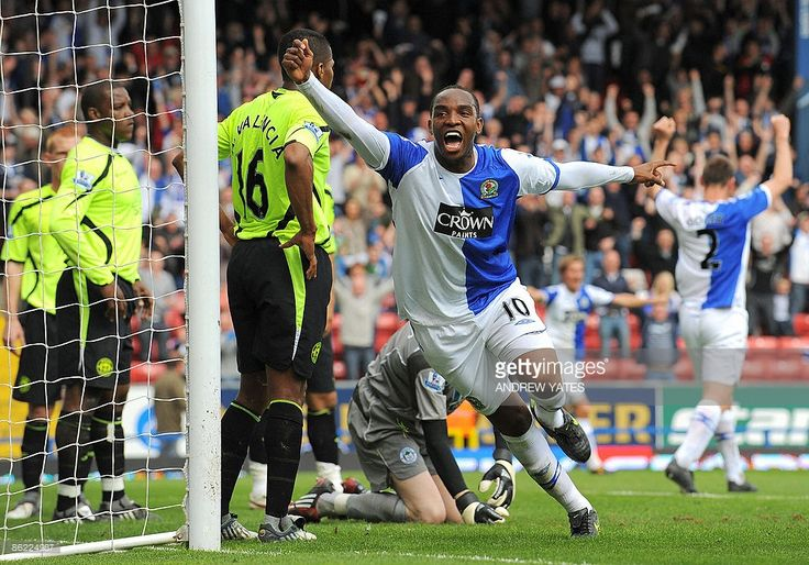 Blackburn Rovers' South African forward Benni McCarthy (C) celebrates after scoring the opening goal during the Premier league football match against Wigan Athletic at Ewood Park, Blackburn, north-west, England, on April 26, 2009. AFP PHOTO/ANDREW YATES. FOR EDITORIAL USE ONLY Additional licence required for any commercial/promotional use or use on TV or internet (except identical online version of newspaper) of Premier League/Football League photos. Tel DataCo +44 207 2981656. Do not…
