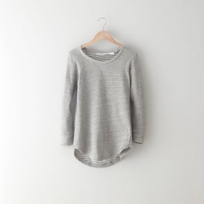 Soft, double layer knit tee with torqued side seams and striped lining.    • 3/4 length raglan sleeves  • curved side seams & hem  • slim fit  • 100% cotton