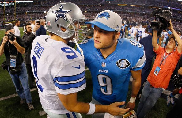 Tony Romo Photos Photos - Quarterback Tony Romo #9 of the Dallas Cowboys talks with quarterback Matthew Stafford #9 of the Detroit Lions after the Cowboys beat the Detroit Lions 24-20 during a NFC Wild Card Playoff game at AT&T Stadium on January 4, 2015 in Arlington, Texas. - Wild Card Playoffs - Detroit Lions v Dallas Cowboys