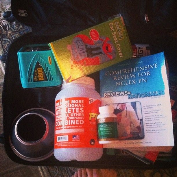 My life in a nutshell.. Err.. Suitcase. #promasil #protein #advocare, amino acids, #nclex book, kids carseat cover, and studio lights. - http://girlsworkhard.com/my-life-in-a-nutshell-err-suitcase-promasil-protein-advocare-amino-acids-nclex-book-kids-carseat-cover-and-studio-lights/