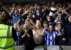 Sheffield Wednesday's fans celebrate in the stands after the final whistle