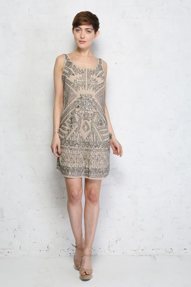 Aztec Beaded Flapper Dress - Go all Gucci with this fabulous catwalk worthy sequinned flapper party dress from Lace and Beads. This Aztec beaded flapper dress is a serious show stopper with blasts of bling beading and attention grabbing linear design which screams deco decadence whilst maintaining a strong contemporary look. 1920s flapper dresses are a killer choice for nights out as the cut is flattering, allows you to shimmy happily and this fierce number will get heads turning in the…