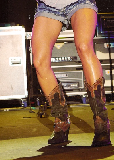 Cowboy boots are so flattering because they hit that sweet ...