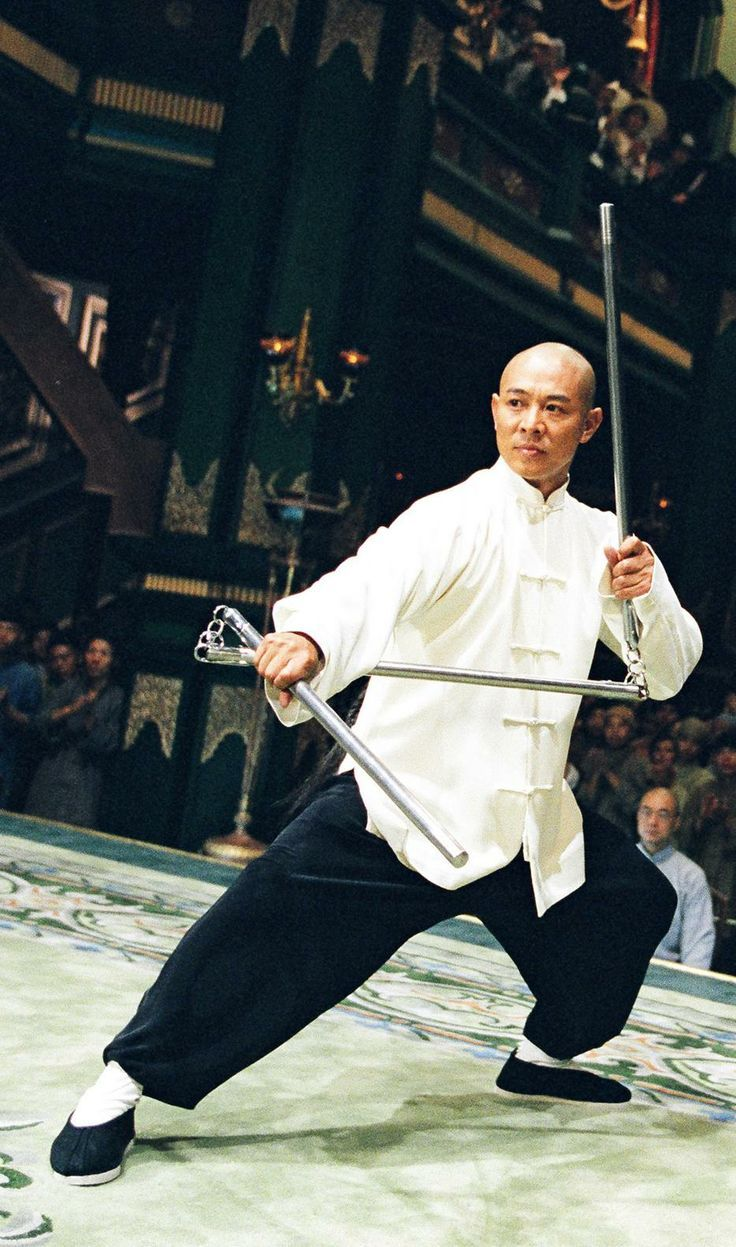 Jet Li- 'Fearless'- wielding a 3 section staff.