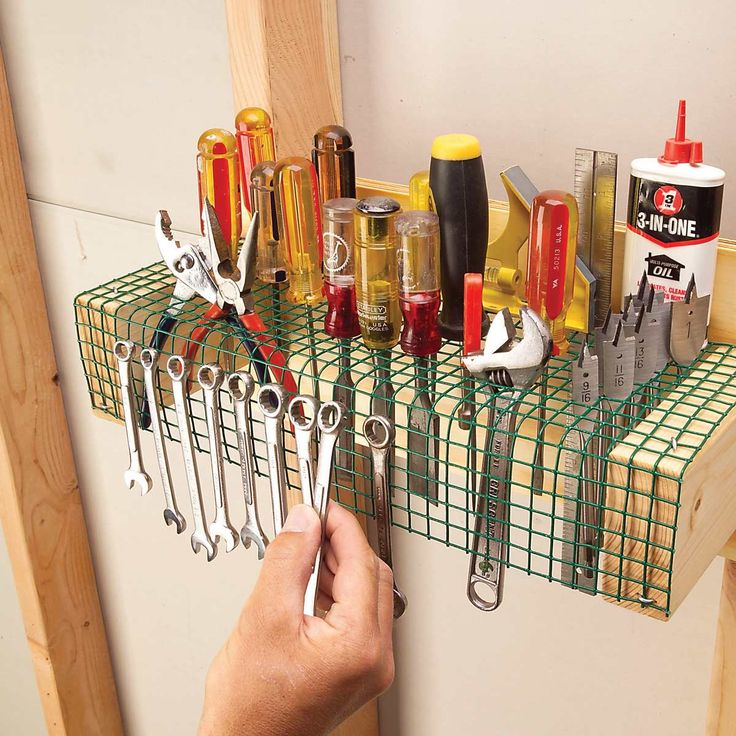Store just about every hand tool you need on a strip of vinyl-coated 1-2-in. wire mesh hardware cloth. Make a frame from a scrap of plywood.
