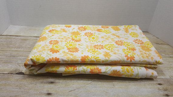 Bright Cheery and crisp! Cute orange and yellow flowers. Queen size  Includes one flat sheet and 2 pillowcases. No fitted sheet included. One tiny spot (pictured) looks like ink maybe?    ****For information about new listings, sales and other fun stuff, follow my BLOG! www.RandomGoodsVintage.blogspot.com  *****For sneak peaks and SECRET SALES, follow me on INSTAGRAM, TWITTER, PINTEREST and TUMBLR! www.instagram.com/RandomGoodsVintage