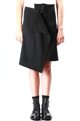 Yohji Yamamoto unbalanced wrap over skirt wrap over skirt in wool blend felted jersey with high ribbed jersey waistband, unbalanced front hem and zip fastening with folded panel effect, above knee length