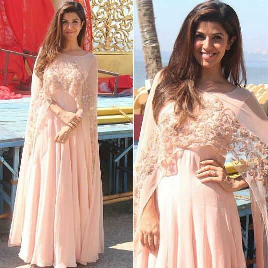 Nimrat Kaur wearing a pale peach dress by Malasa for her movie Airlift Promotions