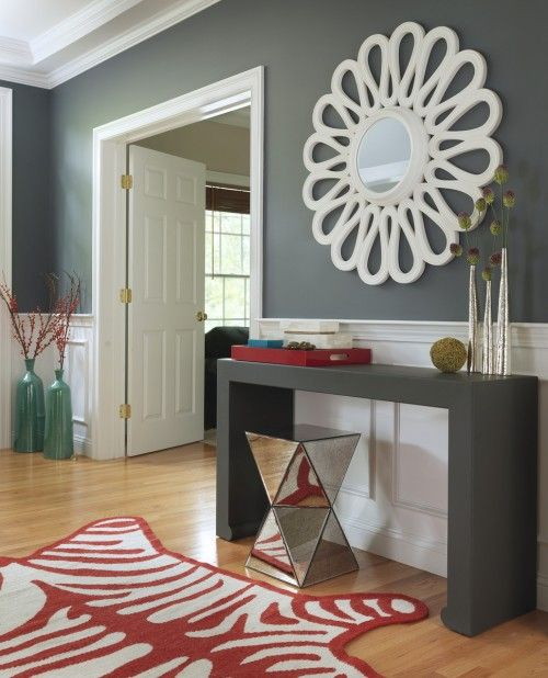 Entryway . . . love the mirror, love the slate, red and teal-ish color combo. Oh yeah, love the zebra rug,too. Always a sucker for zebra.