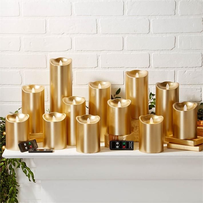 $550.00 Two's Company 15 Pc Gold Dazzler Candle 15 Pc Gold Dazzler Twin Light Flickering Flameless Candle  Unit Includes 2 set of 6 pcs with 2 Timer and Remote-Control Options  Gift Box with 3 Remote Controls  Unscented Wax/Plastic