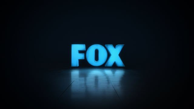 "A 6 ft. tall practical FOX logo was shot to create a ""projection mapped"" look that we could skin in different ways.  To achieve this, a custom FOX 3D model needed to be created and matchmoved to the shot footage.  From there, a UV pass was rendered which we could use in After Effects to layer the custom animations on to the comped, treated footage.  A huge amount of work went in under the hood to get that locked down but once it was, we had a great amount a flexibility.  Check out more…"