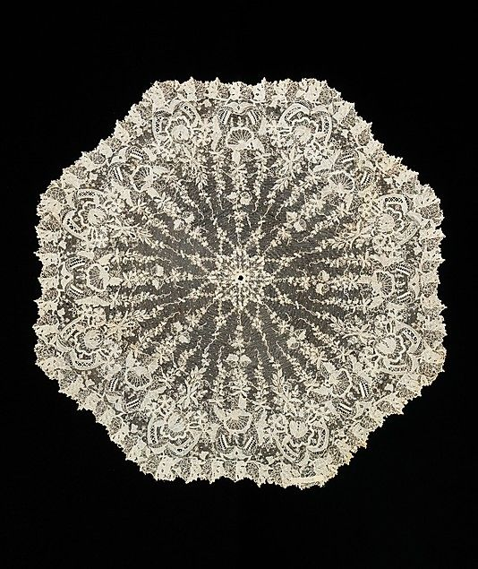 Parasol Cover: lace or decorative cover that was put over the parasol to make it more elaborate looking. These were interchangeable and used as a piece of art work. Belgian lace Parasol cover