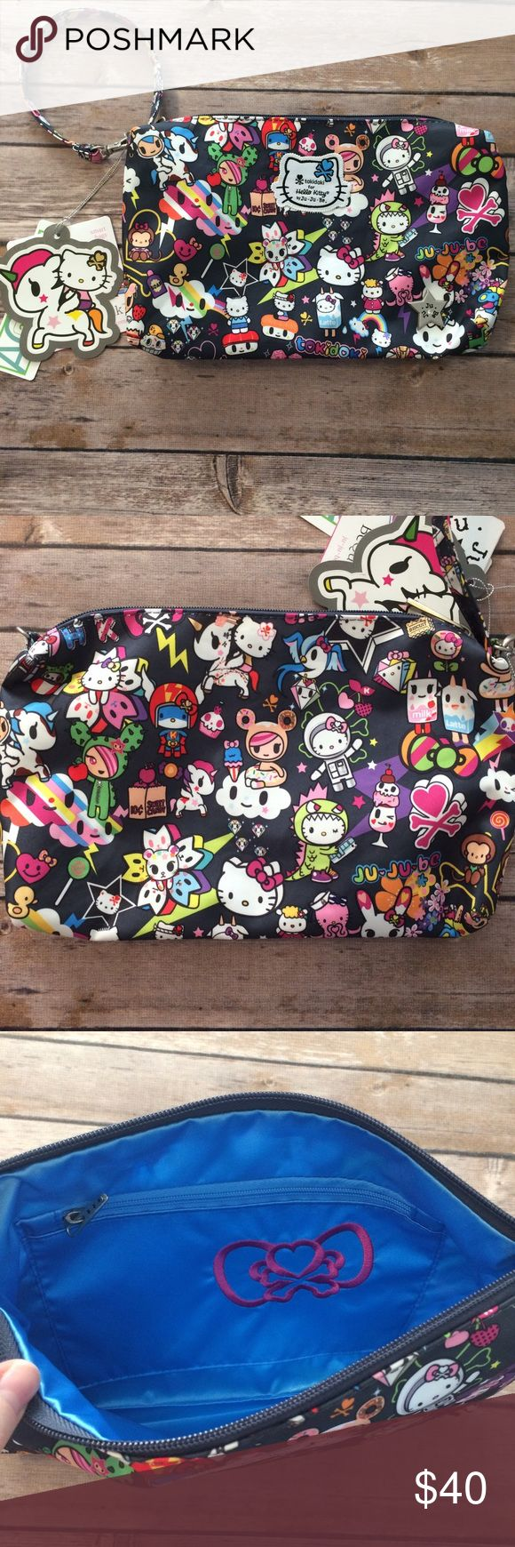 Tokidoki for hello kitty by jujube be quick Wristlet/diaper pouch. New with tags. Internal zip pocket. Dream world print. Great donutella and Sandy placement on back.  Don't think these are available retail any longer. Smoke free dog friendly home. tokidoki Bags Baby Bags
