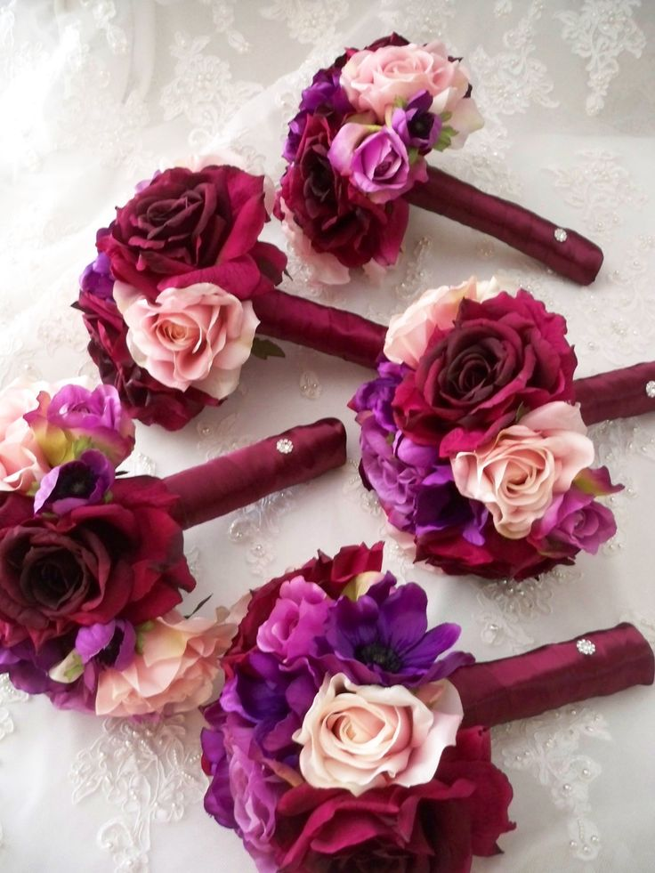 14 piece Package Sangria  Silk Rose Bridal  Bridesmaids  and Boutonniere Destination Wedding Bouquet Set. $445.00, via Etsy.