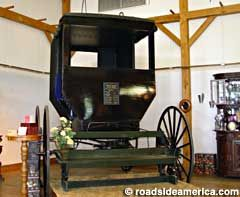 World's Largest Amish Buggy, at Wendell August Forge, Berlin, Ohio. 10 ft. 1.5 in. tall, 13 ft. 9 in. wide, 1,200 lbs.