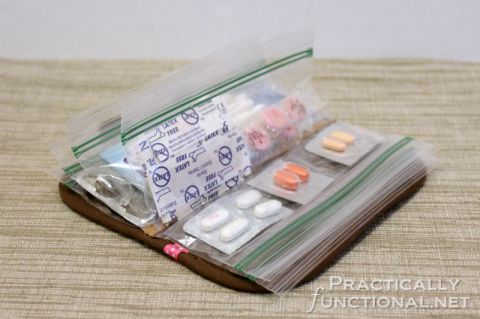 DIY Purse Organizer From A Hot Pad -- make one for meds and first aid kit, another for coupons. Get hot pads from the dollar store, then sew on patches to personalize it