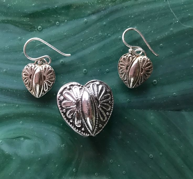 Silver metal clay earring and pendent set.