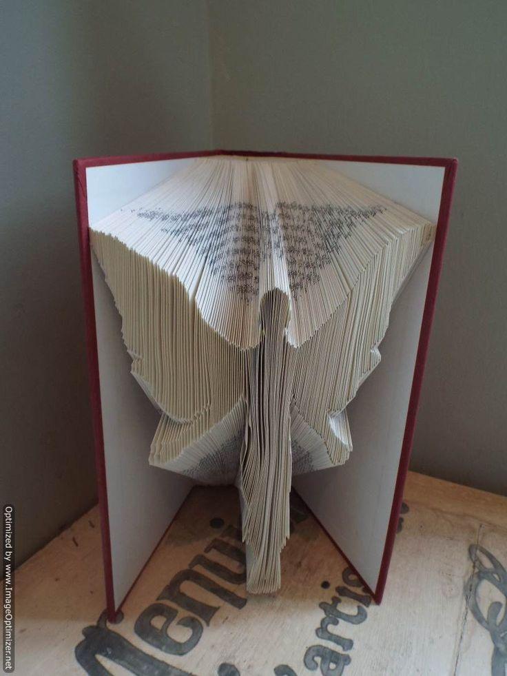 Book folding pattern  of an Angel . FREE Pattern maker included !! by BookArtCo on Etsy https://www.etsy.com/no-en/listing/204573270/book-folding-pattern-of-an-angel-free