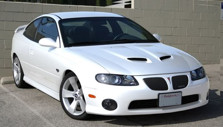 This is the best 2006 GTO I've ever seen. I hate to be a copycat, but one of these will be mine. Oh yes... it will be mine. I love the GTO (obviously), and I am just drawn to white vehicles. If this color had been offered from the factory, I'd have bought one new. Time to find one and start sanding. :)