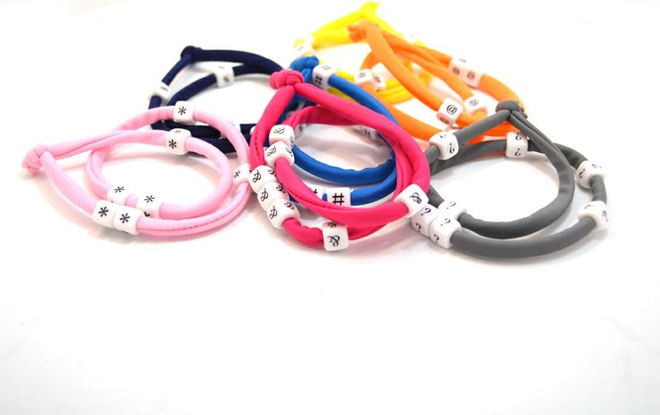 Lycra cord bracelets in many colors embellished with white keyboard symbols. Choose desirable color: pink, fuchsia, orange, yellow, grey, navy blue, intigo blue. Choose desirable symbol: @, #, $, %, &, *, ?.Choose Length approx. 40 cm. Each. Two (2) turns each round the wrist. Adjustable bracelet, fits to all wrist sizes. Comes in a gift bag.