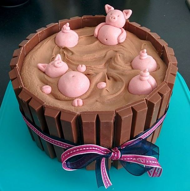 Pigs in the mud (kitkat fence, milk chocolate ganache cake and marzipan pigs)