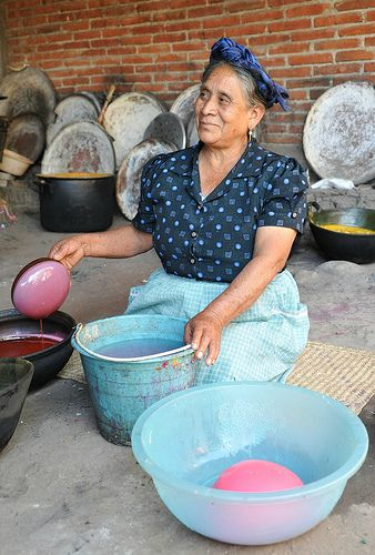 """making wax roses that she will use to decorate her famous """"velas de concha"""" candles. Mexico"""