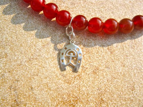 Horseshoe & Indalo charm in sterling silver on Carnelian choker - hung this way up for luck in many cultures/countries