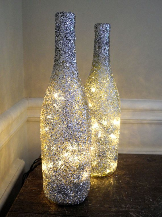 Sparkly coated wine bottle lights...cute decor for a windowsill at Christmas time with garland too