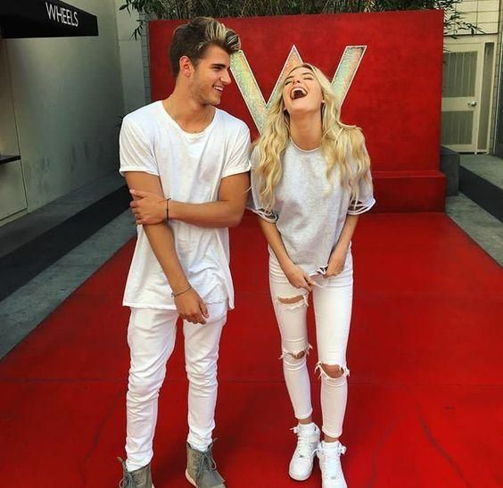 Lele Pons wears a pair of damaged white skinny jeans