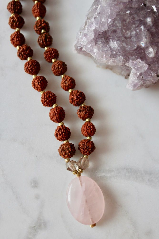 Soul Mate Mala - Rose Quartz is the crystal of unconditional Love. Rainbow Moonstone blesses one with the energy of joy and healthy optimism. Rutilated Quartz illuminates the soul as it encourages spiritual growth on all levels.