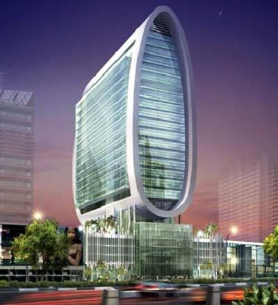 Oval Tower - located in the business bay area featuring 19 floors of office space and a luxury deck with a gym. Divided into the tower and the podium, the project also holds retail space. It is designed by Atkins Architects.