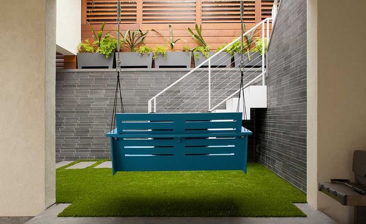Smooth Grey Stone Feature Wall with Swing in Courtyard in San Francisco