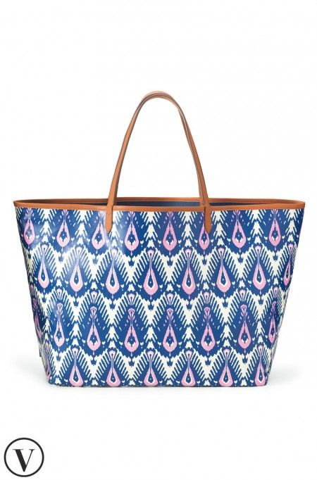 This blue and pink reversible tote bag is perfect for your summer getaways! Use for the beach or a weekend away. Shop tote bags at Stella & Dot.