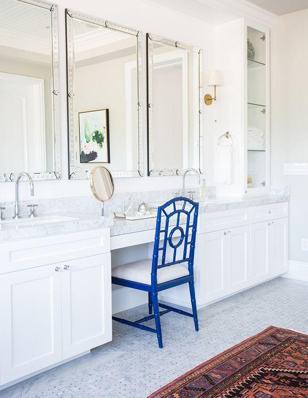 A cool blue stool and warm rug prove opposites attract.   Photographer: Tessa Neustadt   Designer: Studio McGee
