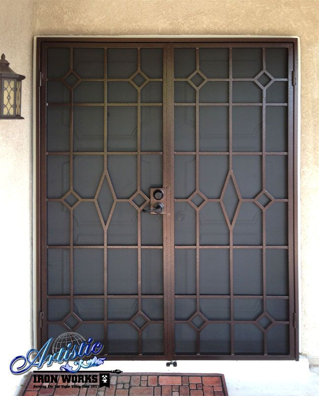 Elegant iron clad security wrought iron double security for Security doors for french doors