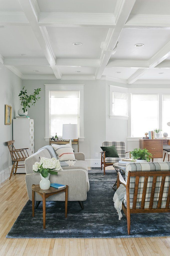 Painting a wooden ceiling in an old home can make the space feel bright and airy.