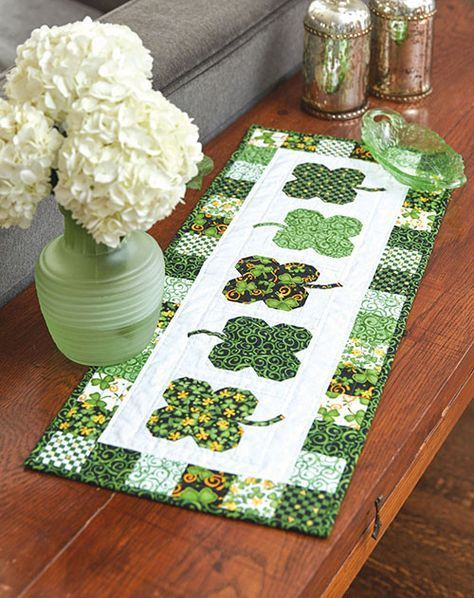 This pieced four-leaf clover table runner pattern uses pre-cut 2 -1/2