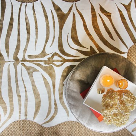 I have been longing for a zebra print rug for ages and finally bought myself a large piece of canvas dropcloth and some Rust-Oleum Universal metallic in pure gold so that I can make my own zebra print rug. Once you've got the design done, painting and finishing your own zebra print rug is quite easy. http://www.home-dzine.co.za/crafts/craft-zebra-print-rug.htm