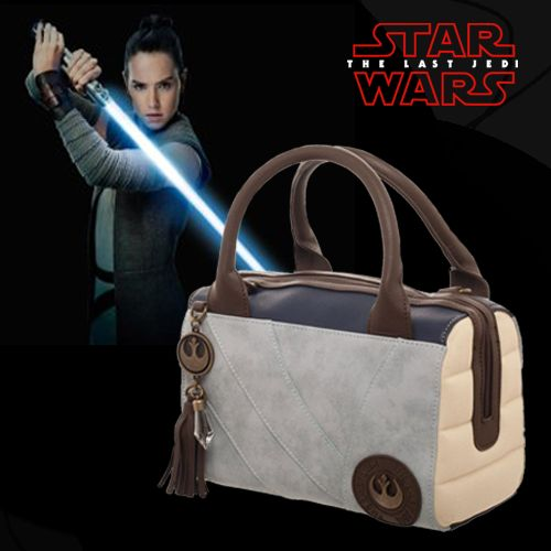 Add a dash of Star Wars: Episode VIII - The Last Jedi to your wardrobe! The Last Jedi Rey Satchel Purse is based on Rey's costume and includes the Rebel symbol, along with a crystal tassel charm.
