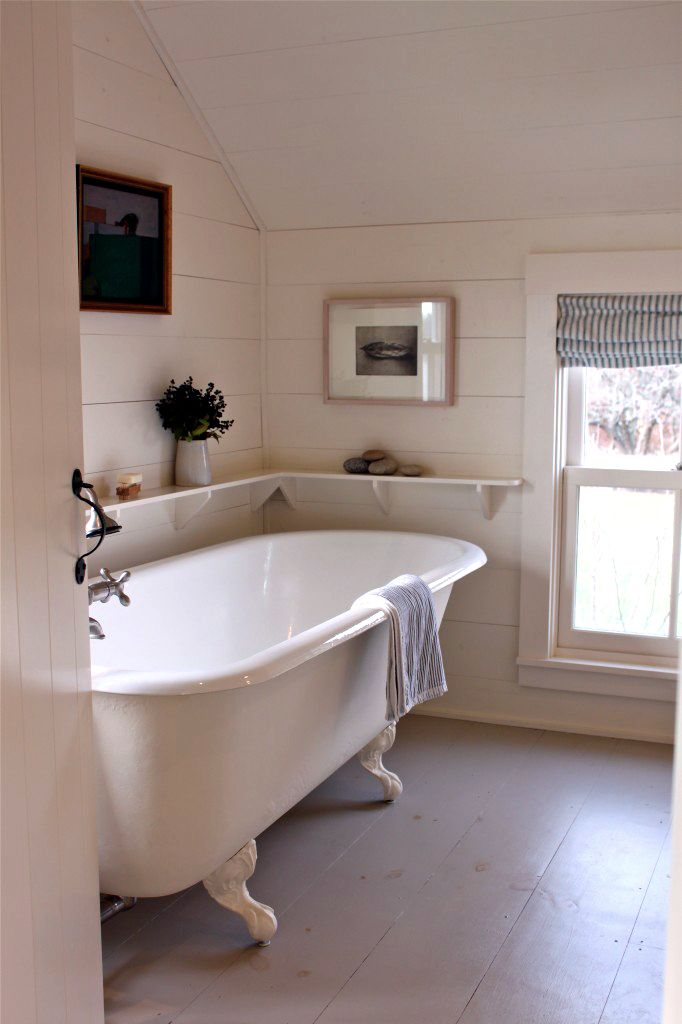 Cottage bathroom: timber panelling/roll top bath