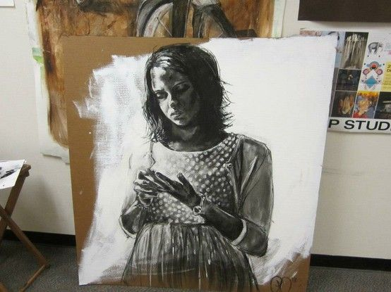 Girls in Ms. Leake's art class are working on large scale self-portraits using black and white charcoal on gessoed cardboard.