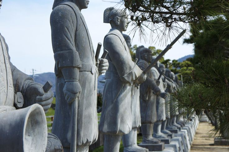 Stone statues of the 47 ronin line the entrance to Oishi Shrine in Ako.
