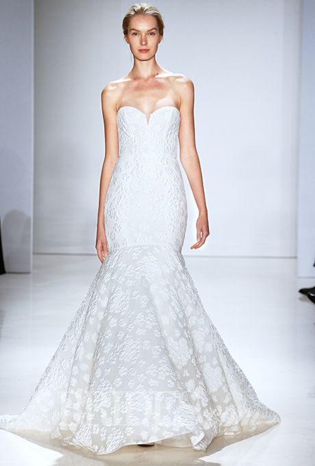 A form-fitting gown with a trumpet hem by @amsale | Brides.com