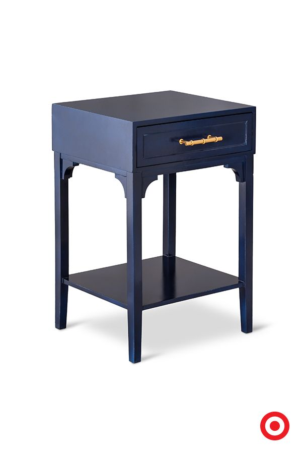 Navy accents, like this single-drawer table, are a great way to bring color into a room without overpowering the rest of the space. Next to a couch or chair, or even on its own, this table will give your room an instant refresh.