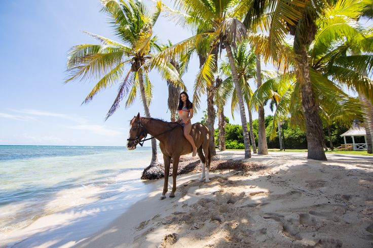 Go horseback riding in the ocean on your own time with a stay at Half Moon Resort in Montego Bay, Jamaica where they have their own equestrian centre.