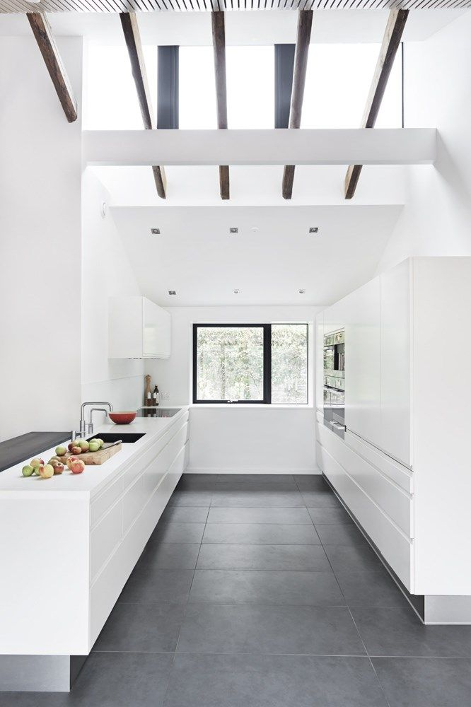 Dark grey floor with very modern white kitchen, likey