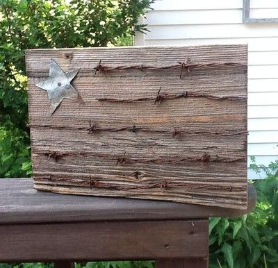 Rustic Patriotic Primitive Flag from Vintage Barn Siding and Rusty Barbed Wire Love this guy's stuff! Check him out on eBay-- seller  s*sleepingdog