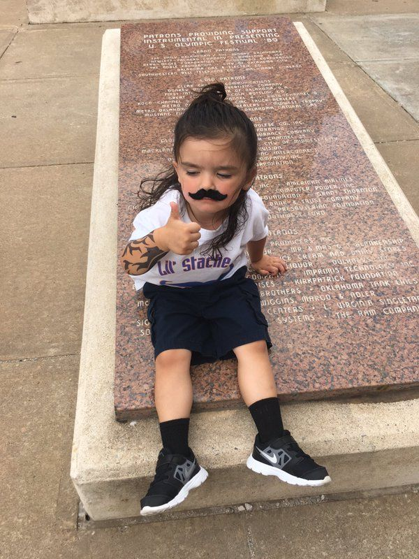 Yo this little girl going Steven Adams mustache/tattoo combo has already won fan of the game